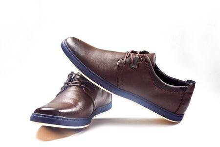 Photo pour Men fashion brown shoe leather over white background. Pair casual stylish footwear. Close up - image libre de droit