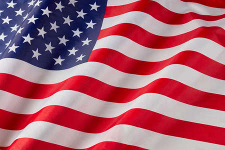 Photo pour Close up of ruffled American flag. Satin texture curved flag of USA. Memorial Day or 4th of July. Banner and freedom concept - image libre de droit