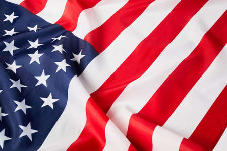 Photo pour Close up of ruffled American flag. Satin texture curved flag of USA. Memorial Day or 4th of July. Banner - image libre de droit