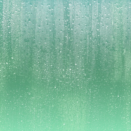 RAIN DROPS ON GLASSの写真素材