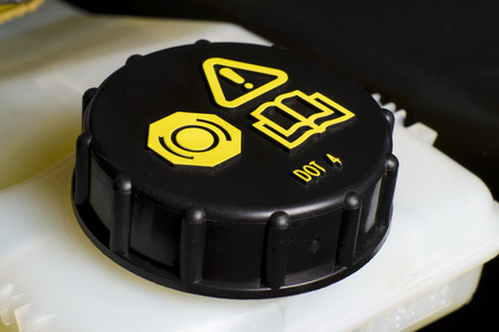 Vehicle maintenance fragment, Brake and clutch fluid check cap with black cap and yellow warning information