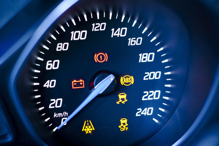 Photo presents car s, vehicle s speedometer or tachometer with visible information display - ignition warning lamp  and brake system warning lamp, visible symbols of instrument cluster   ten check warning light , with warning lamps illuminated