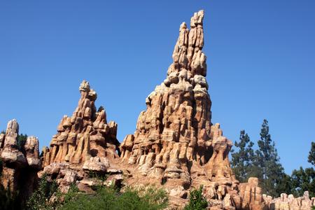 Big Thunder Mountain, Disneyland, Anaheim, California , runaway mine train cart rattles tourists wildly around a haunted mountain in open and through tunnels