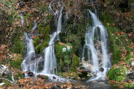 Mossbrae falls in Dunsmuir, California, beautiful waterfalls in Shasta Cascade area, 15 m high and 53 m wide, fed by springs, flow into Sacramento river.