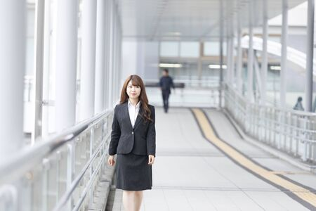 Business woman walking in the aisleの写真素材