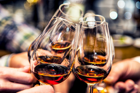 Photo for Group of friends a toast to the cheers of cognac or brandy Cheers  - Royalty Free Image