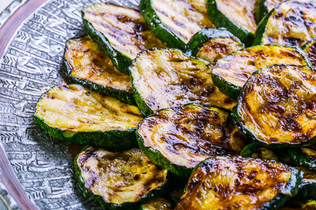 Zucchini. Grilled zucchini. Slices of grilled zucchini on a plate. Vegetarian - Mediterranean cuisine.