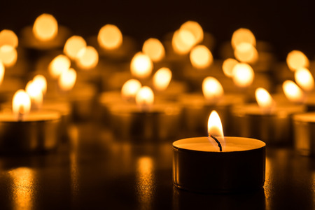 Photo pour Candles light. Christmas candles burning at night. Abstract candles background. Golden light of candle flame. - image libre de droit