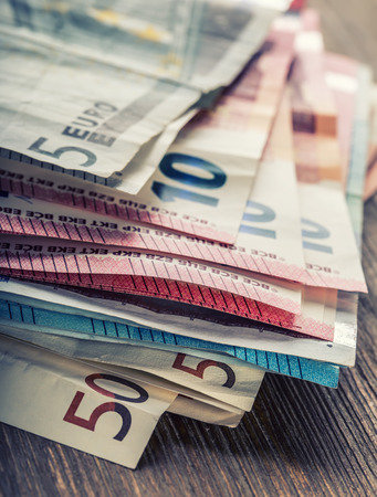 Several hundred euro banknotes stacked by value. Euro money concept. Euro banknotes. Euro money. Euro currency. Banknotes stacked on each other in different positions. Toned photo