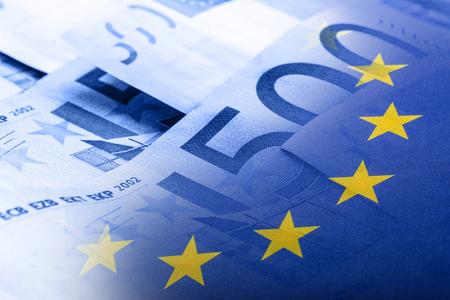 Foto de Euro flag. Euro money. Euro currency. Colorful waving european union flag on a euro money background. - Imagen libre de derechos