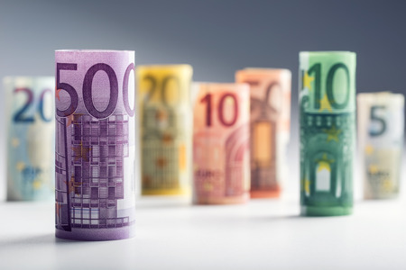 Photo pour Several hundred euro banknotes stacked by value. Euro money concept. Rolls Euro  banknotes. Euro currency. Announced cancellation of five hundred euro banknotes. Banknotes stacked on each other in different positions. Toned photo. - image libre de droit