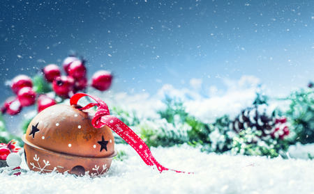 Foto für Christmas balls jingle bells. Red  ribbon with text Happy Christmas. Snowy abstract background and decoration. - Lizenzfreies Bild