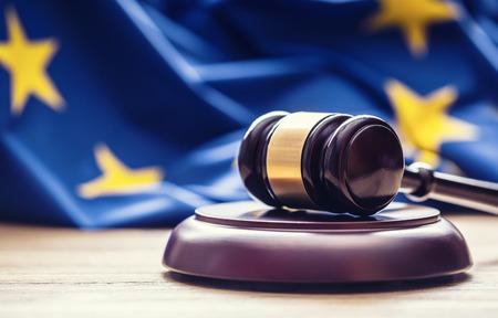 Foto de Judges wooden gavel with EU flag in the background. Symbol for jurisdiction. - Imagen libre de derechos