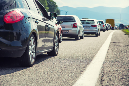 Foto de Traffic jam on the highway in the summer holiday period or in a traffic accident. Slow or bad traffic. - Imagen libre de derechos