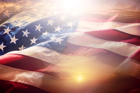 Photo pour USA flag. American flag. American flag blowing wind at sunset or sunrise. Close-up.  - image libre de droit