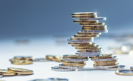 Foto de Euro coins stacked on each other in different positions. Close-up european money and currency. - Imagen libre de derechos