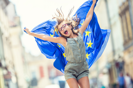 Photo pour Cute happy young girl with the flag of the European Union. - image libre de droit