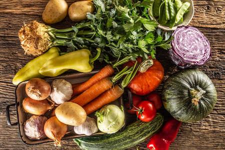Foto für Selection of autumn vegetable harvest from the top on a rustic surface. - Lizenzfreies Bild