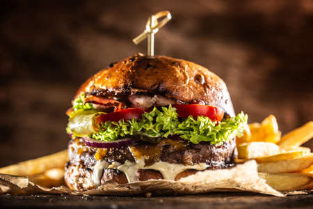 Photo pour Classic beef burger with cheese cheddar bacon wegetable and french fries. - image libre de droit