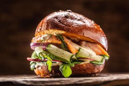 Foto de Salmon burger stuffed with vegetable salad avocado and dill. - Imagen libre de derechos