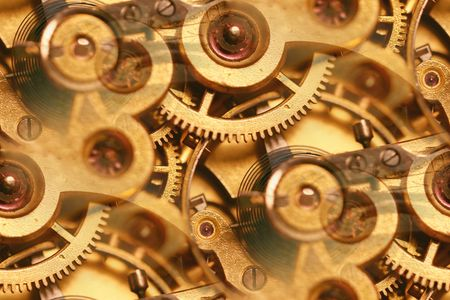 clockwork mechanism abstract; inner workings of an antique fob watch