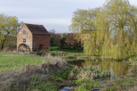 Foto per Hartpury Mill, Highleadon, Gloucestershire, UK  Brick grade II listed Watermill - Immagine Royalty Free