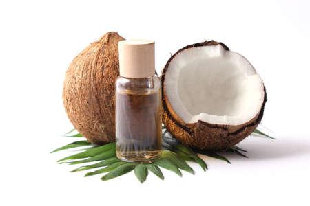 Foto für coconut oil and coconuts, palm branches close up - Lizenzfreies Bild