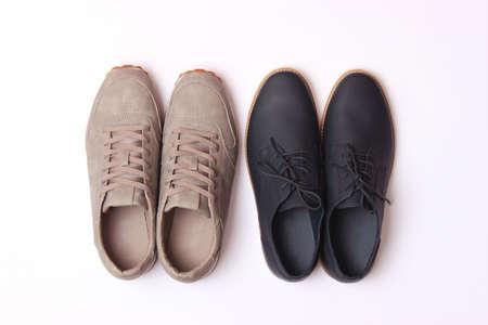 Photo pour mens office shoes and sneakers on a colored background top view. mens shoes, - image libre de droit