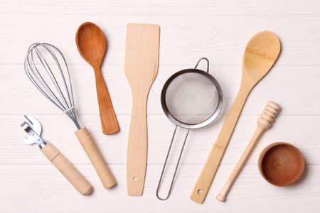 Photo pour different kitchenware on a light background top view. Cooking appliances. - image libre de droit