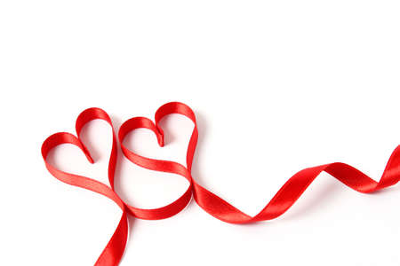 Photo pour hearts from ribbons on a white background top view. - image libre de droit