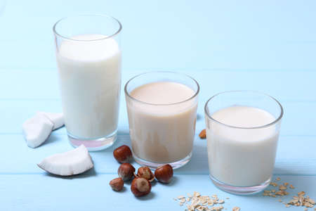 Photo for Different types of vegetable milk on the table. - Royalty Free Image