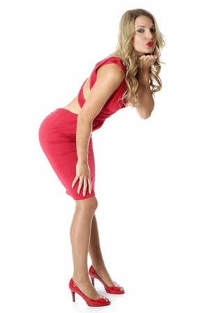 Model Released. Sexy Young Woman Wearing a Red Dress