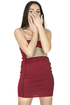 Attractive Young Woman Covering Her Mouth Laughing Wearing A Sexy Short Red Mini Dress