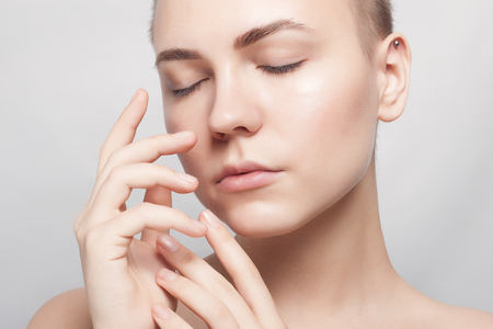 Photo for Beauty Portrait. Beautiful Spa Woman Touching her Face. Perfect Fresh Skin. Pure Beauty Model. Youth and Skin Care Concept - Royalty Free Image