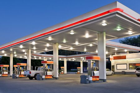 Photo for Horizontal shot of a retail gasoline station and convenience store at dusk. - Royalty Free Image