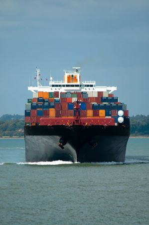 fully loaded container ship head-on in calm water