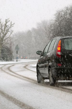 vehicle traveling on a highway during snowfall