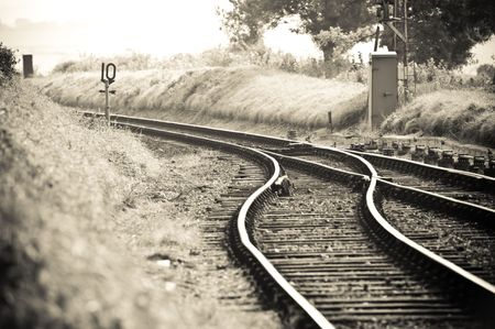 old fashioned rail tracks merging into one