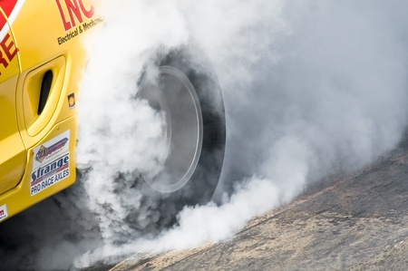 Santa Pod Raceway, UK - April 23, 2010: Closeup of a dragster tire burnout at the Big Bang Camper and Bus Festival at Santa Pod Raceway, UK