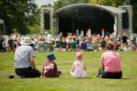 Yateley, UK - July 2, 2011: Family of four attending the Gig On The Green summer music festival in Yateley, UK.
