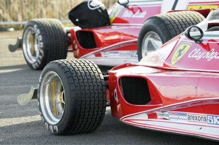 Blackbushe, UK - March 5, 2012: Vintage Ferrari Formula 1 cars on the film set of Rush, a movie directed by Oscar winner Ron Howard,