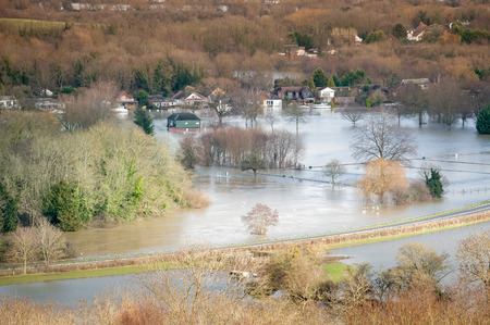 landscape of luxury homes and farmland under river floodwater