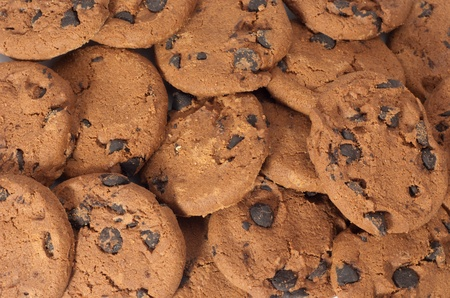 Close up of delicious chocolate chip cookies background. Just out of the oven, freshly baked.