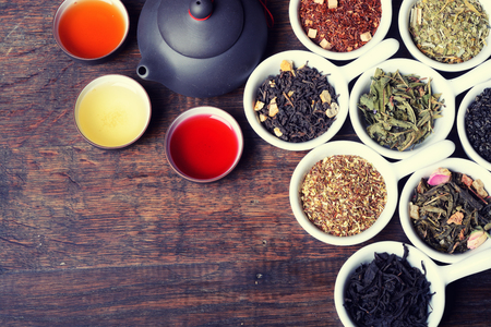 assortment of dry tea on wooden background