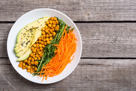 Photo for Buddha bowl with avocado , cucumber , carrot and chickpea . Healthy vegan salad food - Royalty Free Image