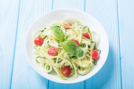 Photo for Zucchini pasta noodles with tomatoes . Healthy vegetarian food - Royalty Free Image