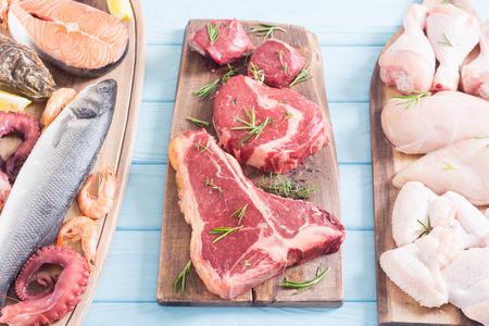 Foto de Assortment of meat and seafood . Beef , chicken , fish and pork - Imagen libre de derechos