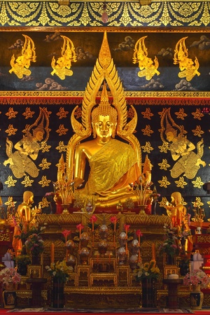 Attractively golden Buddha in Thai temple.
