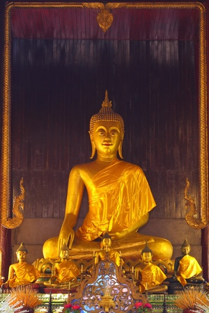 old Buddha in wood temple.chiangmai Thailand.