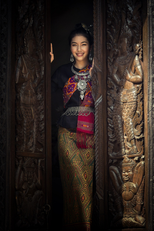 Asian woman in traditional dress. Beautiful woman dressed in silk.